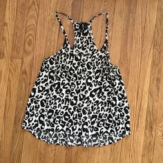 H&m animal print tank Never worn, super cute cheetah tank in white and black. Size 8 at H&M, would fit a small H&M Tops Tank Tops
