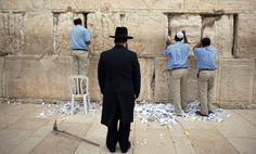 Men help remove messages and prayers written by thousands of people addressed to God from the cracks in the Western Wall in preparation for the up coming Jewish Passover holiday on March 28, 2012 in Jerusalem's old city, Israel. All the notes once collected will be buried in a special place at the Mount of Olives.according tro Jewish law. Passover begins in the evening of Friday, April 6 and commemorates the story of the Exodus where the ancient Israelites were freed from slavery in Egypt…