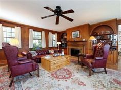 Library w/ working fireplace off Living Room. A magnificent room opening onto upper slate terrace