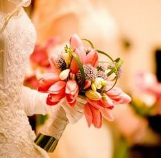 http://brideorama.com/tulip-wedding-bouquets/