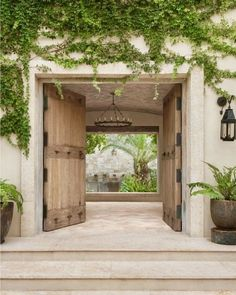this courtyard entry - that chandelier, Spanish stone, aged wood doors, black hardware & vines. Courtyard Entry, Courtyard House, Spanish Courtyard, Internal Courtyard, Spanish Garden, Modern Courtyard, Spanish Style Homes, Spanish House, Hacienda Style