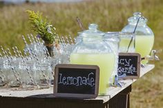 Lemonade for a back yard wedding - Love the straws!
