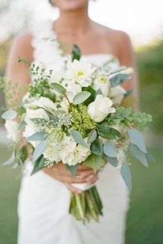 white wedding bouquets with greens white flowers and roses diany pranata via instagram