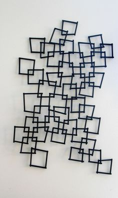 Inspired by DIY   knock off PB wall sculpture   DIY geometric wall decor   This is our Bliss   www.thisisourbliss.com