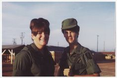 Marilyn Roth (left) and Lee Wilson, both in field uniforms, stand together at a military facility in Long Binh, Vietnam, circa 1968.