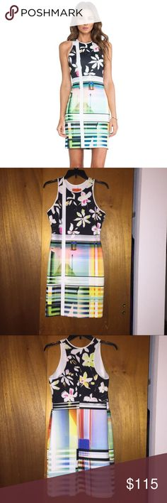 Clover Canyon garden plaid body con dress Body con dress with floral and colorful geometric scheme makes it a stand out! It'll match any occasion and you. Size large but it is a tight dress so works with well with a smaller frame as well, especially if curvy. 34DD and 27-28 size jeans wearing it Clover Canyon Dresses