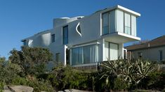 Seacliff House by Chris Elliott Architects. The walls of this house in Sydney feature curved openings that look like gills. Situated in the seaside suburb of Bronte, Seacliff House overlooks the ocean and has pools on two floors.
