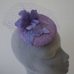 Lilac sinamay based fascinator finished with veiling and a large velvet orchid. This piece is from the Limited Collection and will not be re-made unless as a custom order This oval shaped sinamay fascinator measures approximately across. Lilac Flowers, Fascinator, Veil, Orchids, Textiles, Velvet, Shapes, Dwarf Lilac, Headdress