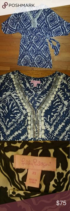 Lilly Pulitzer dress This is such a flattering dress..on all body types! Slouchy top and sinches nicely around the waist to show some shape. Beautiful detail around the v-neck line. Color is navy and white. Lilly Pulitzer Dresses Mini