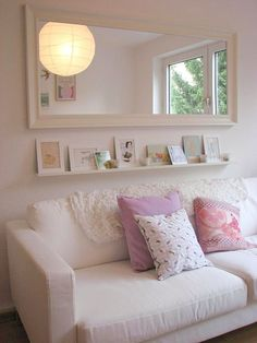 spare room, den, office, feminine, yoga / meditation room, airy, love the look of the big paper machette ball hanging light for this room. Also notice the position of mirror, shelf, and frames. Very clean.