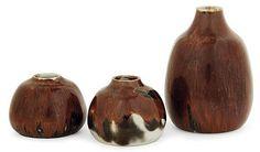 Auguste DELAHERCHE (1857-1940) - A small potbellied enamelled porcelain vase. Enamelled signature. Height. 1 1-2 in. - Diam. 1 7-8 in. - A small ovoid enamelled porcelain vase. Enamelled signature. Height. 3 1-8 in. - A small piroform enamelled stoneware vase. Carved signature. Height. 4 3-4 in.