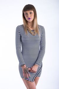 Black and white stripes and a overlapped asymmetric front hemline come together in the Clique Dress! The Clique Dress features long sleeves with plenty of stretch. We love to team the Clique Dress with chunky black heels and a bright Queen lippy from Bang Cosmetics ! Black Heels, Bangs, Hemline, Stripes, Bright, Cosmetics, Queen, Black And White, Long Sleeve