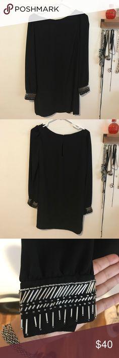 Rachel Roy black dress- never worn! Rachel Roy black mini dress with beaded detail on sleeve. Never worn! It was too tight on my bum, I like loose clothing :) RACHEL Rachel Roy Dresses Mini