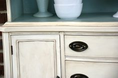 Great tips for creating an aged look on furniture just by layering different colors of paint.  canarystreetcrafts.com