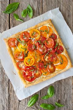 Tomato Recipes - Tomato, Goat Cheese, and Caramelized Onion Tart - Fresh tomatoes get baked in a flakey puff pastry shell with goat cheese and caramelized onions. Tart Recipes, Veggie Recipes, Brunch Recipes, Appetizer Recipes, Vegetarian Recipes, Cooking Recipes, Healthy Recipes, Veggie Food, Recipes Dinner