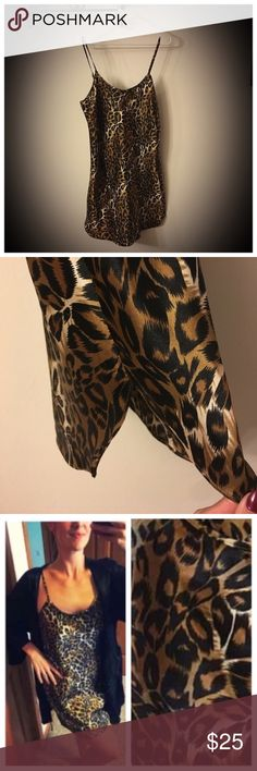 """Sexy leopard nighty/chemise with adjustable straps 📦Same day shipping (as long as P.O. is open for business). ❤ Measurements are approximate. Descriptions are accurate to the best of my knowledge.  This silky leopard print nighty will make you feel beautiful at bed time. Flat measurements: Across bust 18.5"""" and 28"""" long not including the adjustable strap length. 100% soft silky polyester. Slight slits at each side  (5.5"""" in length) with a cute bow in the front. No holes/stains or blemishes…"""