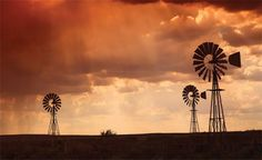 Picture of Brewing thunderstorm in the dessert area of the Karoo in South Africa just before sunset. Three wind pumps silhouetted against the skyline with sunbeams shining through the clouds. stock photo, images and stock photography. Before Sunset, Kruger National Park, Thunderstorms, Ciel, South Africa, Cool Photos, Sunrise, Clouds, Stock Photos