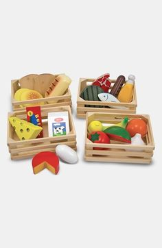 Melissa and Doug Food Groups Set. Be sure to stock the play kitchen with healthy options. This is cool because it also teaches the food groups. Could be augmented with even more fruits and veggies and such
