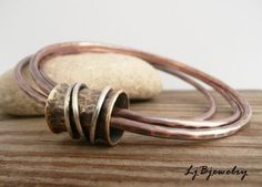Copper Bangle, Mixed Metal Bangle, Stacking Bangle, Triple Bangle,Copper, Brass, Sterling Silver, Metalsmith Jewelry, Handmade For the bangle lovers out there this bracelet is made of copper, red brass, and sterling silver. The red brass spinner ring hold