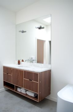 Lots of storage in this vanity by Kerf Design. Not crazy about the countertop or mirror, though.