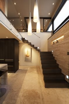 Love the natural light, stairs, floor, wooden wall and modern light fixtures.
