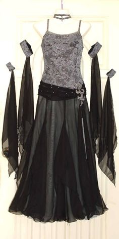 Black and silver lace ballgown-style dress with arm bands - I think this would be just as good for cabaret style bellydance as it would for ballroom dancing.