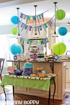 Party food arrangement ~ LOVE the banners hanging from the pendant lights and the whole setup!!! I've got to do this!!