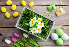 easter holiday background with fowers eggs and bunnies
