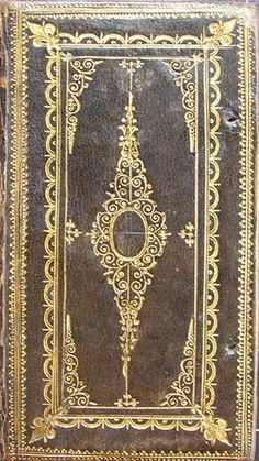 17th-century English gold-tooled black morocco binding, with a design that continues on the spine. From a volume containing four sermons by Anthony Tuckney printed 1654-6.