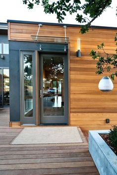 Front Doors: Minimalist Wooden Villa With Peace Nuance Awesome Entrance Door With Transparent Glass Canopy And Torch Door Inspirations Front Door Front Door Inspirations: Appealing Front Door Canopy Idea For Contemporary Ideas