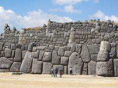 Sacsahuaman is an Incan walled complex near Cusco, Peru, made of large polished dry stone walls with boulders carefully cut to fit together tightly without mortar. It is a UNESCO World Heritage site.