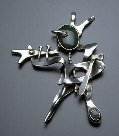 Brooch   Sam Kramer. 'Trumpeter' Silver, gold, chrysacolla chalcedony, Burmese ruby, labradorite.  1952.
