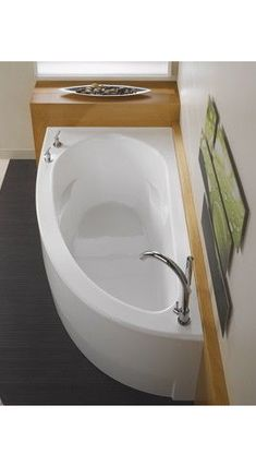 An odd shaped bath tub adds a focal point to a room. Great for bathrooms with larger walls, or anywhere you don't want the tub to take up the whole wall.