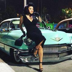 WEBSTA @ latinavamp - I'm a permanent hood ornament 💋📸 @rondizzzle #elvelorio2016 #56caddie #pinup #latinavamp #girlwirhtattoos @la_vida_rockabilly @ratrodz_n_pinups @jaroslav_classic @pinupworship
