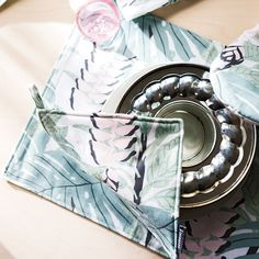Finlayson Bunaken Green / Pink Placemat Set Add dimension to your family's dinner table with the Bunaken placemats by Finlayson. Designed to capture attention with natural elements, these placemats will surely add character to your table setting.
