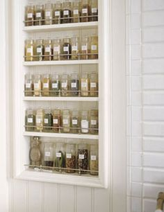 simply smart.  exposed spice rack near the range. I'd love to have a real spice rack.