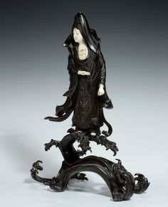 Japanese bronze and ivory female figure of Kannon (1868-1912)
