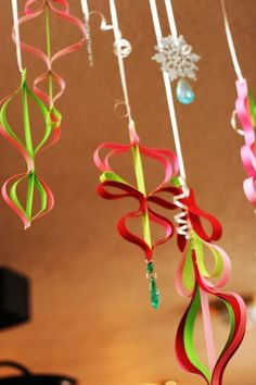 hanging paper ornaments-couldn't find a tutorial to go along with, but will use as inspiration. Reminds me of How the Grinch Stole Christmas. Grinch Christmas Party, Grinch Party, Office Christmas, Noel Christmas, Homemade Christmas, Christmas Projects, Holiday Crafts, Christmas Ornaments, Grinch Christmas Decorations