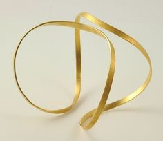 Not sure how this would look on me, but I like the minimalist, modern style of the bracelet.  It's in 22k gold.