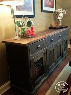 Rustic Sideboard-- chicken wire cabinet doors, oil rubbed bronze cup pulls... what's not to love about this?!