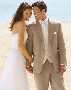 Champagne/Khaki colored tux. Perfect for destination and beach weddings. You can dress it up with all accessories, or dress it down with little or no accessories. love the ivory vest  tie on white shirt. Makes the ivory pop.