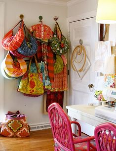 bags bags bags! Love the pink chairs too :) studio.3 by annamariahorner, via Flickr