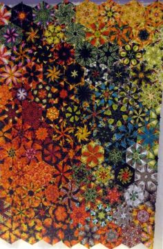 Jenny's Star Fishes, My sister Jennifer Davis-Ford is my inspiration for this One Block Wonder Quilt. Dizzied by a sea of orange and black fishy kaleidoscopes she schooled me on color placement and encouraged me to follow my passion for quilting. If you look closely you can find fish in many of the blocks. This is my first quilt using the kaleidoscope technique and my first quilt show entry in a show this spring! It is machine pieced and machine quilted. , , Special Occasions Project