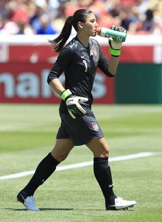 Goalkeeper Hope Solo #1 of the USA takes a drink during a game against Canada during the second half of the women's Olympic send-off soccer match June 30, 2012 at Rio Tinto Stadium in Sandy, Utah. The USA beat Canada 2-1.
