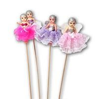 kewpie dolls on sticks at the carnival in the 50's