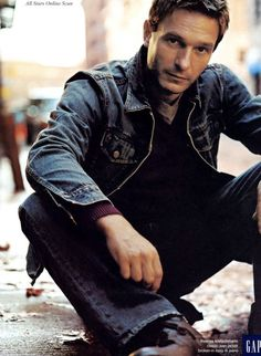 Gerard Besson - pictured here all in denim, as he appears for the first time in the book, during the scene at the Bistro du Stade (actor Thomas Kretschmann)