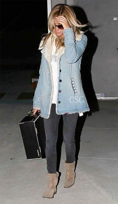 #AshleyTisdale looked comfy in a looked cute in a Chaser Outlaw Tank and Free People Faux Shearling-Lined Denim Coat when she was spotted shopping at Barneys New York in Beverly Hills December 20, 2012     #CelebrityStyleGuide
