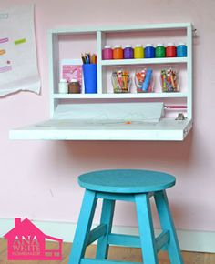 For a simple arts-n-crafts space, the drop down table top with storage for paint and brushes is perfect.