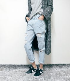 Light washed boyfriend jeans, sneakers and grey shirt that isn't a high contrast with the pants. Sweater adds interesting color and texture contrast (almost greenish).