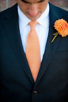 Love the tie! The light shade of orange looks great with the white button-down and the navy blue blazer!
